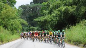 Cyclists riding through the tropical forest in Gabon - Wednesday 15 January 2014