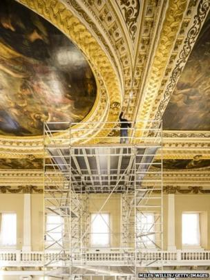 Preventive conservation co-ordinator at Historic Royal Palaces Jonathan Bridal inspects the Rubens ceiling paintings for damage during a conditioning survey at Banqueting House in London