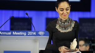 Artist Shirin Neshat holds the Crystal award