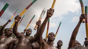 The Queen's baton is greeted with a display of traditional culture, music and dancing in Yaounde, Cameroon.
