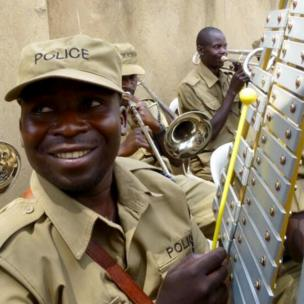 The local police band welcomes the baton in great style in the Ugandan capital, Kampala.
