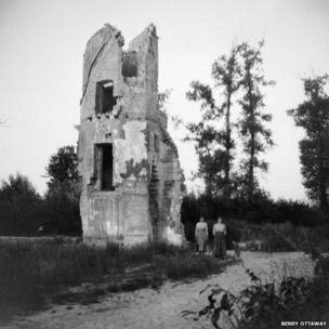 Destroyed building with two glum women