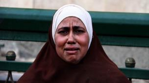 Woman crying at scene of blast in Cairo (24 Jan 2014)