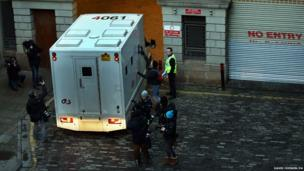 Members of the media photograph a prison van arriving at Edinburgh Sheriff court as Rosdeep Kular, mother of three-year-old Mikaeel Kular, is expected to appear at the court later today
