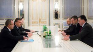 Ukrainian President Viktor Yanukovych (second left) holds talks with opposition leaders Oleh Tyahnybok, Vitaly Klitschko and Arseniy Yatsenyuk