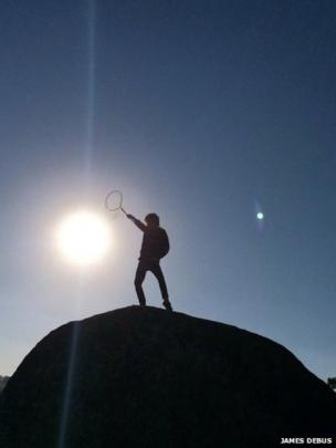 Joey Debus, the sun and an unidentified object in the sky. Photo: James Debus