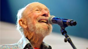 Pete Seeger performing on stage during a Farm Aid concert in September 2013