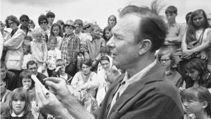 Pete Seeger conducts an instrument making session on Children's Day at the Newport Folk Festival, Rhode Island in July 1966