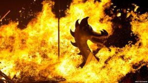 Viking boat in flames