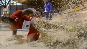 Zimbabwean athlete Ngoni Makusha landing in a long jump event, Bordeaux, France - Sunday 26 January 2014