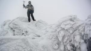 Chris Hargraves at Ben More Assynt's summit in Sutherland