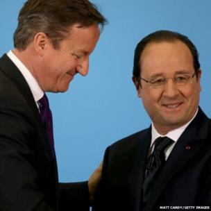 British Prime Minister David Cameron and French President Francois Hollande shake hands at a press conference in Brize Norton, England