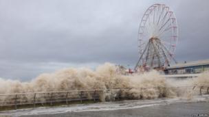 Waves crash on the Blackpool promenade. Photo: Steve Rawling