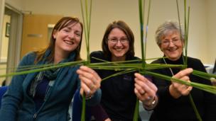 Deborah McLaughlin, Lizzy Pinkerton of the Belfast Hills Partnership and Geraldine Carragher show off their efforts