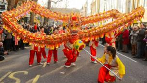 A Chinese dragon swoops along central London
