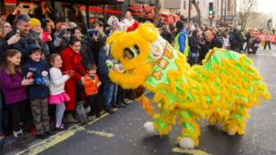 Performers dressed as a Chinese Dragon greet crowds during the annual Chinese New Year parade through central London