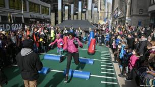 fans play on obstacle course