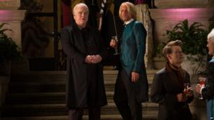 "Philip Seymour Hoffman as Plutarch Heavensbee, left, and Woody Harrelson as Haymitch Abernathy in a scene from ""The Hunger Games: Catching Fire."""