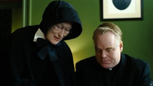 "Philip Seymour Hoffman portrays Father Flynn, right, and Meryl Streep portrays Sister Aloysius in a scene from ""Doubt."""