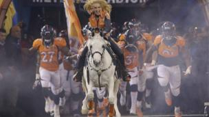 Thunder leads the Denver Broncos players onto the field