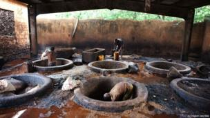 Men work in a leather tannery in Niamey, Niger