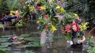 Horticulturalists Ellie Biondi and Alex De Hoyle arrange plants