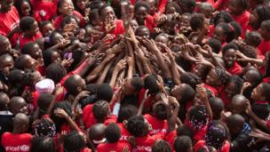 Children in Matola reaching towards the Queen's Baton, Mozambique - Wednesday 5 February 2014