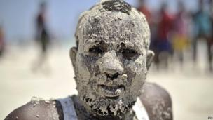 A man with his face covered in sand, Mogadishu, Somalia - Friday 31 January 2014