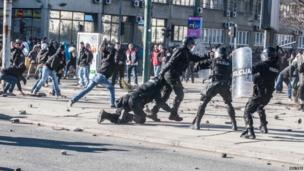 Protesters clash with police in Sarajevo. Photo: 7 February 2014
