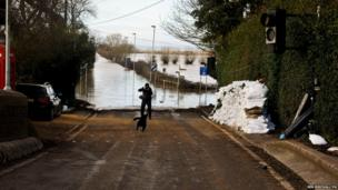 Sandbags sit ready for use should water levels rise in the village of Burrowbridge, Somerset
