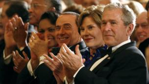 President George W Bush, First Lady Laura Bush and Italian Prime Minister Silvio Berlusconi watch a performance of the musical Jersey Boys