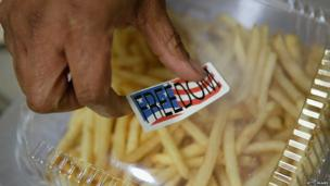 "A cashier put a ""freedom"" sticker on top of a box of ""Freedom Fries"" at a cafeteria in the US Capitol building in March 2003"