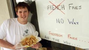 "Restaurant owner Neal Rowland holds a plate of his ""freedom fries"" in February 2003 in Beaufort, North Carolina"