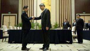 "Wang Yu-chi, head of Taiwan's Mainland Affairs Council, left, shakes hands with Zhang Zhijun, director of China""s Taiwan Affairs Office, right, before their meeting in Nanjing, in eastern China's Jiangsu Province"