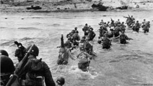 American troops landing on Normandy beaches as reinforcements during the D-Day attack in June 1944