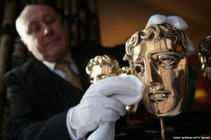 BAFTA mask awards are polished by a butler at the Savoy Hotel ahead of the British Academy Film Awards on Sunday 16th February, on February 10, 2014 in London, England.