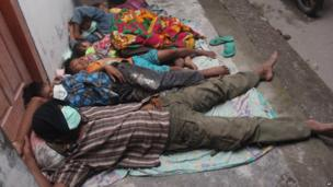 Villagers sleep at a temporary shelter after they were evacuated from their homes on the slopes of Mount Kelud in Kediri, East Java, Indonesia, 14 February 2014