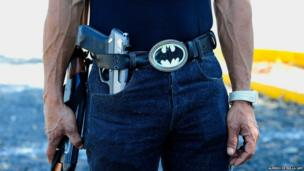 A man poses with a Batman belt in Michoacan