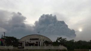 Volcanic clouds seen from Kediri town in East Java province.