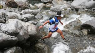 An athlete on a mountain run