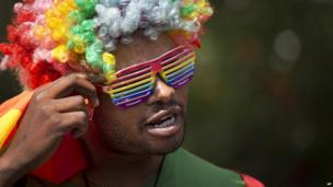 A man in a rain-coloured wig and glasses, Nairobi, Kenya - Monday 10 February 2014
