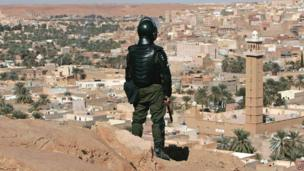 An Algerian policeman looking at a view of Ghardaia, Algeria - Saturday 8 February 2014