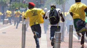 ANC supporters running away from police in Johannesburg, South Africa - Wednesday 12 February 2014