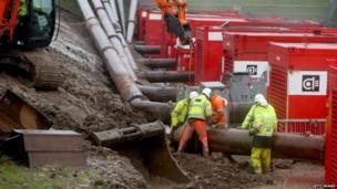 Engineers install pumps