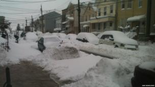 A residential street covered in snow in Jersey City, USA. Photo: Sam Borolossi