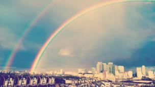 A rainbow over Canary Wharf in east London. Photo: Nick Struggles