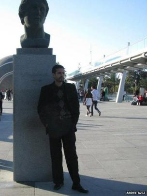 Abdel Aziz, Alexandria, Egypt stands under a statue of Alexander the Great.