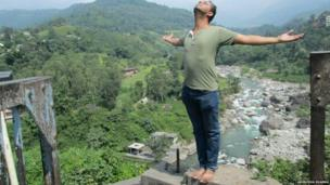 Anirudha Sharma with arms out in Himachal Pradesh in northern India