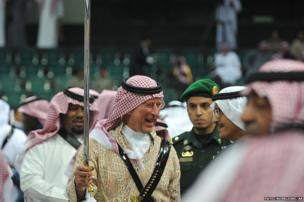 Britain's Prince Charles joins members of the Saudi royal family for the Ardah - or sword dance - in the capital Riyadh