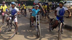 Cyclists take the baton on a trip towards the Royal Palace in Maseru, Lesotho.